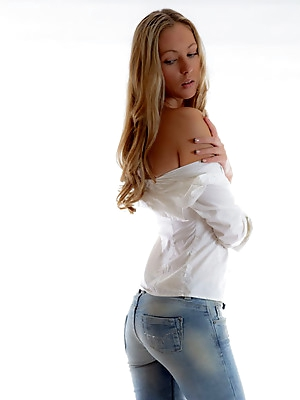 Sexy girl posing in jeans.Erotic girl in jeans - one of the best representatives of the genre of erotica.